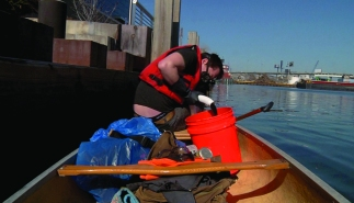 Sludge harvesting with 25' long manual bilge pump