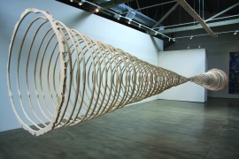 """This piece represents the cross sections of two trees, a familiar reference to nature's clock and a dramatic visualization to time. This large-scale installation illustrates that the life-span of a tree is measured in centuries, and by inference, reminds us that human life is most often measured in decades. In a fast-paced, short-attention-span culture, this vivid reminder gives us pause. The """"clocks"""" also reference Felix Gonzalez Torres Untitled (Perfect Lovers) that is comprised of two synchronized clocks that inevitably become out of synch. Similarly, my piece serves as a symbol of time's inexorable flow. (Photo credit: Tammy Rae Carland)"""