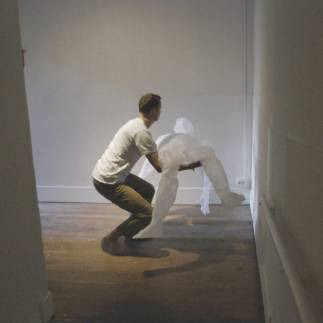 Incline Gallery is a space made up of three long ramps that were formerly used to push bodies up to a morgue on the second floor. For this performance, I carry a negative version of myself through the gallery and set it afire at the top.